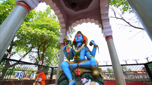 a blue colored shiva statue in hindu temple, india - religion stock videos & royalty-free footage