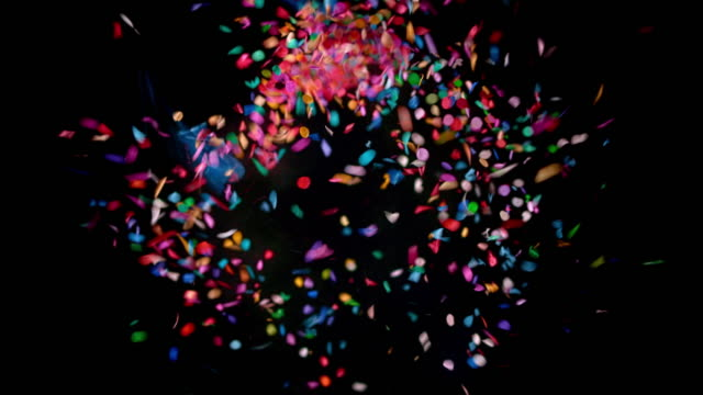 slo mo ld blue confetti balloon popping and releasing the confetti - studio shot stock videos & royalty-free footage