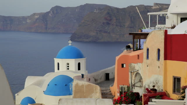 Blue Domed white washed churches of Oia overlooking the Aegean Sea on the Island of Santorini, Greece, Europe