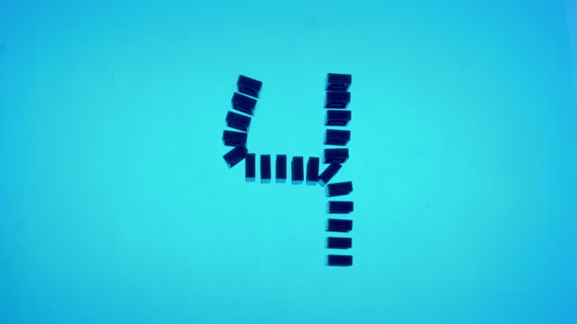 "vídeos de stock e filmes b-roll de slo mo ld blue domino tiles shaped as the number ""4"" falling on blue surface - número 4"