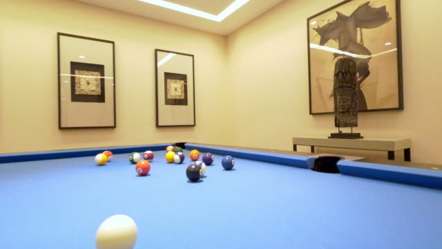 blue elegant billiard table in modern recreaction room 4k