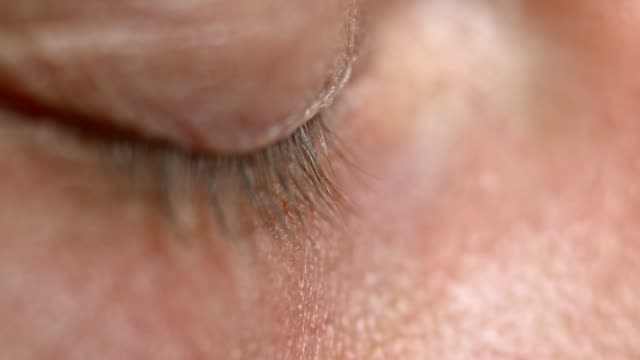 ECU Blue eye of a Caucasian middle aged person