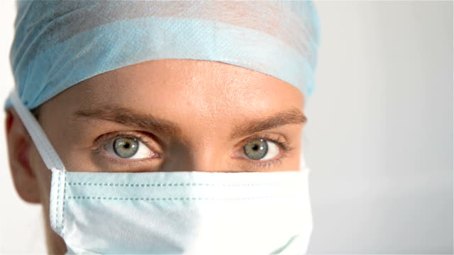 blue eyes of female surgeon - cornea stock videos & royalty-free footage