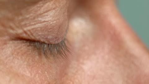 slo mo ecu blue eyes opening - profile stock videos & royalty-free footage