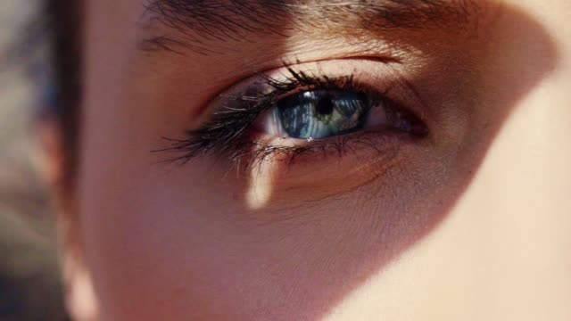 blue eyes portrait. close up - sunlight stock videos & royalty-free footage