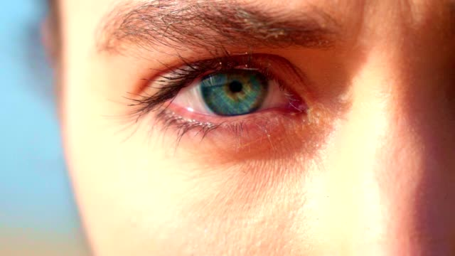 blue eyes portrait. close up - frowning stock videos & royalty-free footage