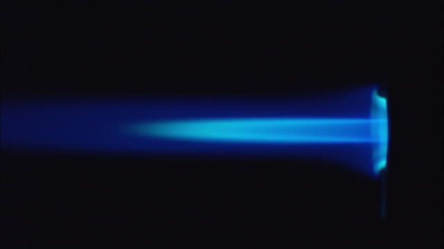 a blue flame shoots out of a piece of scientific equipment. - flame stock videos & royalty-free footage