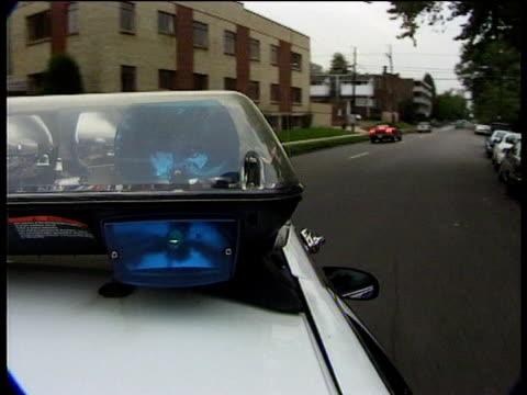 Blue flashing light on top of police car Denver Colorado