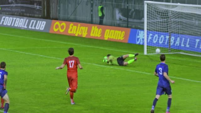 SLO MO Blue football team scoring a goal at the match