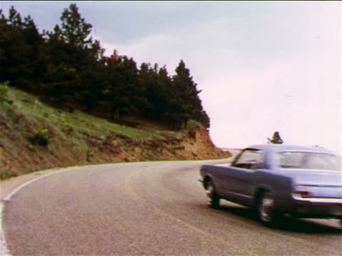 1965 rear view blue ford mustang driving on curvy mountain road / industrial - ford mustang stock videos and b-roll footage