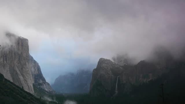 blue & gray winter storm clouds in yosemite valley, looking at el capitan & bridalveil fall, yosemite national park, california - bridal veil falls yosemite stock videos & royalty-free footage