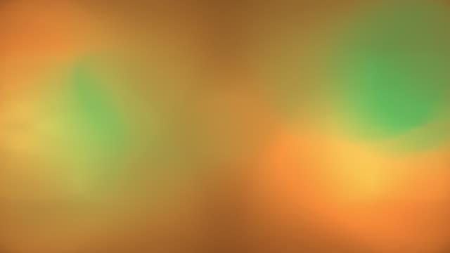 blue, green, and yellow orbs moving about. - オレム点の映像素材/bロール