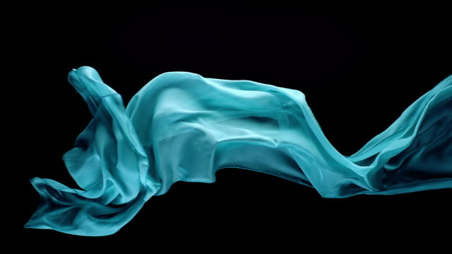 vídeos de stock e filmes b-roll de blue green transparent fabric flowing by wind in black background, slow motion - textile