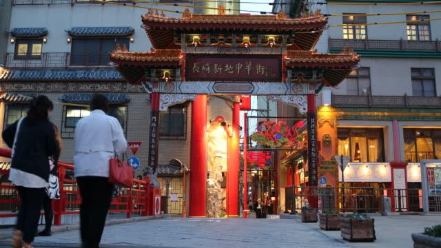 blue hour city scenery with collourful building in nagasaki, japan - armi di distruzione di massa video stock e b–roll
