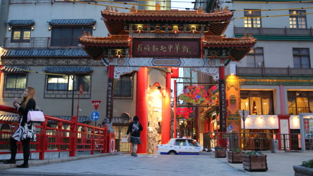 blue hour city scenery with colourful building in nagasaki, japan - armi di distruzione di massa video stock e b–roll