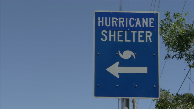 cu zo zi blue hurricane shelter sign / everglades, florida, usa - emergency shelter stock videos & royalty-free footage