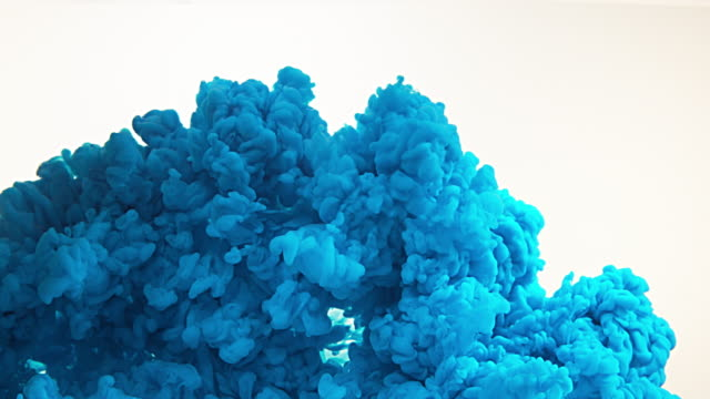 Blue Ink entering Water against white Background, Slow motion 4K