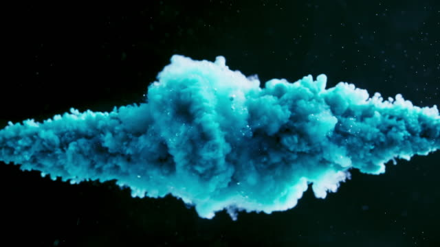 blue ink splash on black background in super slow motion - poster template stock videos & royalty-free footage