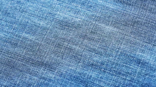 vídeos de stock e filmes b-roll de 4k blue jeans texture close up - jeans