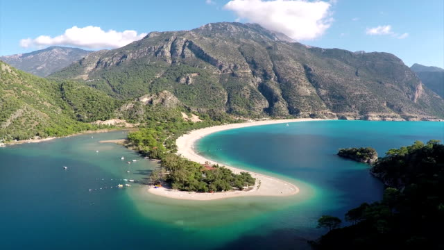 blue lagoon from oludeniz - aerial video - oludeniz stock videos and b-roll footage