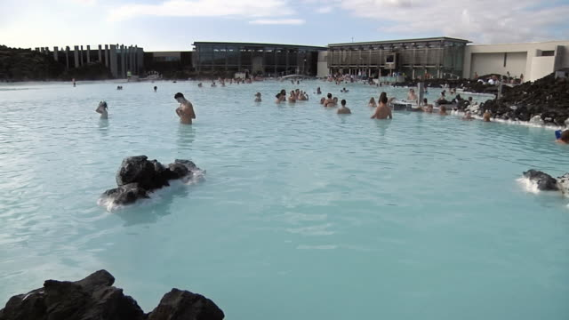 WS PAN Blue Lagoon thermal spa with tourists relaxing in water / Reykjavik, Iceland