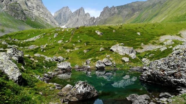 blue lake in roshka - chauki mountain valley, georgia - 東欧文化点の映像素材/bロール