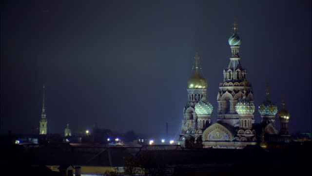Blue lights illuminate St. Basil's Cathedral in St. Petersburg, Russia.