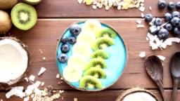 blue majik, spirulina superfood smoothie coconut bowl rotating