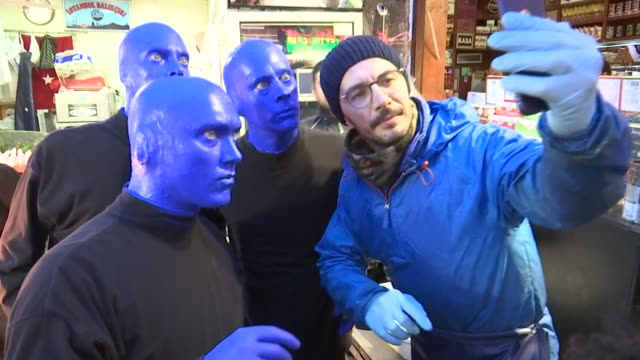 'Blue Man Group' draws attention of people in Istanbul as they stage shows on the streets of Turkey's western province on February 12 2018 The group...