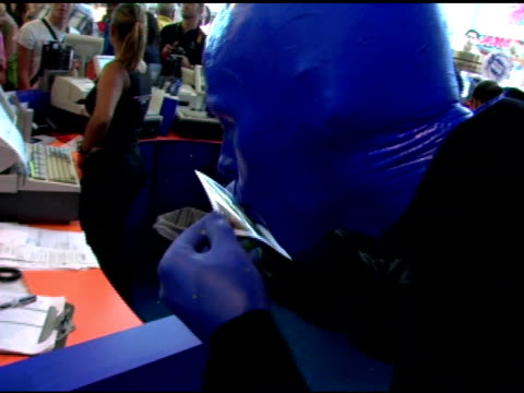Blue Man Group interacts with fans at the Introduction of 'Swatch Blue' by Blue Man Group at Swatch Times Square Store in New York New York on August...