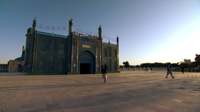 blue mosque in afghanistan with people walking. - mosque stock videos & royalty-free footage