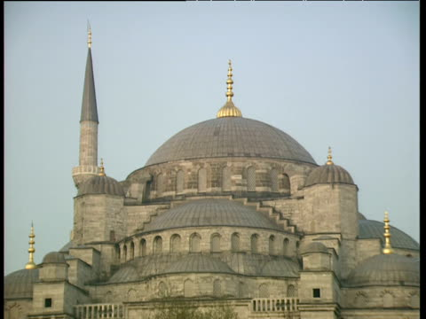 Blue Mosque with main dome surrounded by smaller domes and gold minarets Istanbul
