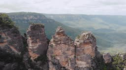 Blue Mountains National Park. Three sisters, beautiful cliffs in the middle of a green bush. Aerial view