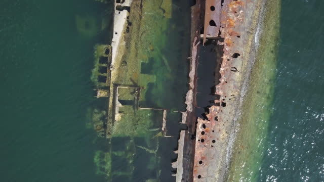 blue ocean and rusty boat - imperfection stock videos & royalty-free footage