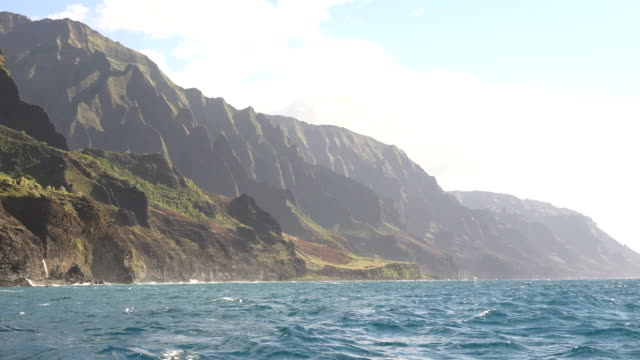 blue ocean on coast of kauai island - butte rocky outcrop stock videos & royalty-free footage