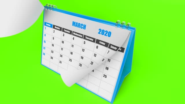 blue pages of calendar 2020 year on green background - calendar stock videos & royalty-free footage