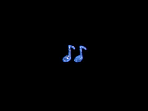 CU blue paper musical note cutouts sparkling with glitter / cutouts of colorful musical notes hanging in front of a black background looks to be...