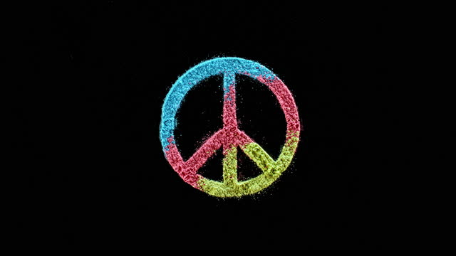 slo mo ld blue, pink and green dust falling onto black surface creating a peace symbol - symbol stock videos & royalty-free footage