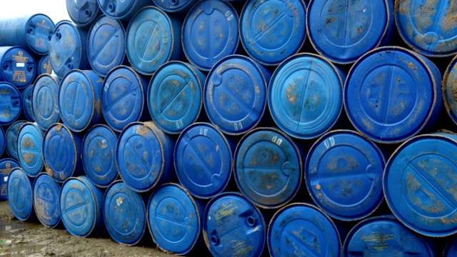 blue plastic barrel - industria petrolifera video stock e b–roll