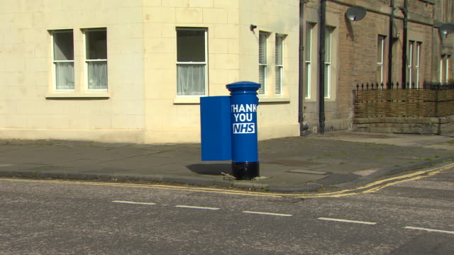 blue postbox in edinburgh to honour nhs workers during the coronavirus crisis - letterbox stock videos & royalty-free footage