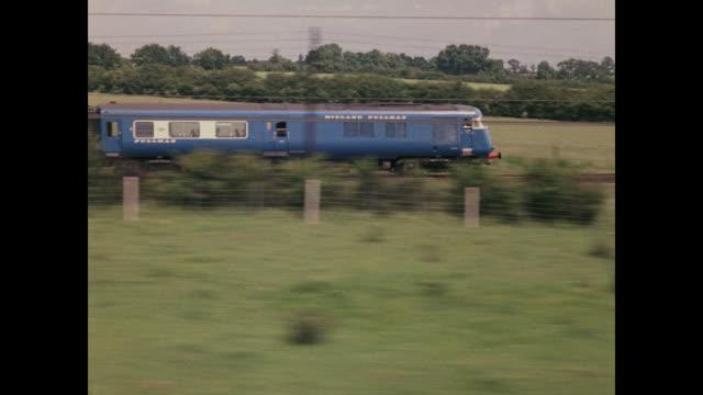 1960 - blue pullman diesel train speeds through countryside - passenger train stock videos & royalty-free footage