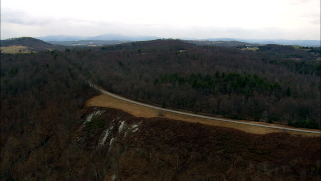 Blue Ridge Parkway Climbing Above Frost Line  - Aerial View - North Carolina,  Surry County,  United States