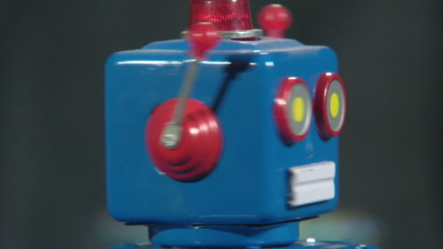 cu blue robot spinning head / dallas, texas, usa  - spielzeug stock-videos und b-roll-filmmaterial