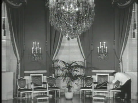 blue room vs male staff member dusting under cushions chairs ha cu french renaissance chandelier ms presidential seal embroidery chair cushion angled... - cushion stock videos and b-roll footage