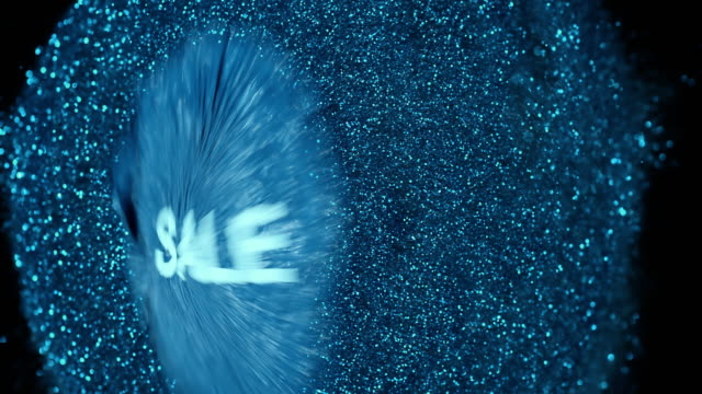 SLO MO blue SALE balloon explodes and glitter is dispersed
