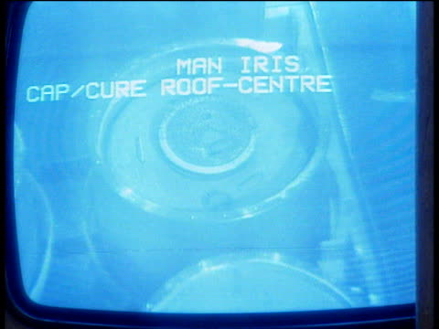 blue screen monitor displaying container of radioactive waste zoom out to man viewing monitor and pressing buttons at sellafield plant - e waste stock videos & royalty-free footage