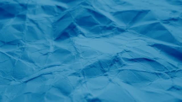 vídeos de stock, filmes e b-roll de mar azul papel - animação em stop motion
