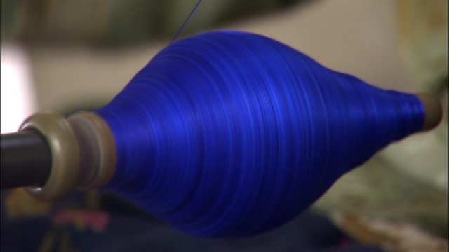 Blue silk being spun onto a bobbin, Hetian, Xinjiang, China