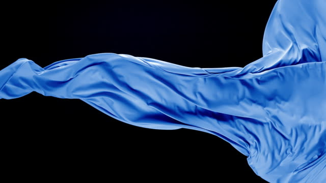 blue silky fabric flowing by wind in black background, slow motion - textile stock-videos und b-roll-filmmaterial