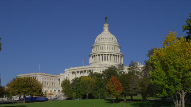 A blue sky outlines the United States Capitol dome on an autumn day in Washington, D.C.